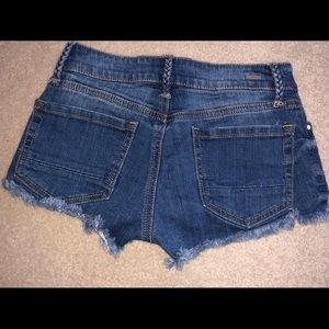 Blue jean shorts with fraying on the end